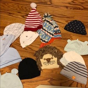 Lots of baby hats ranging from 0-9 months.